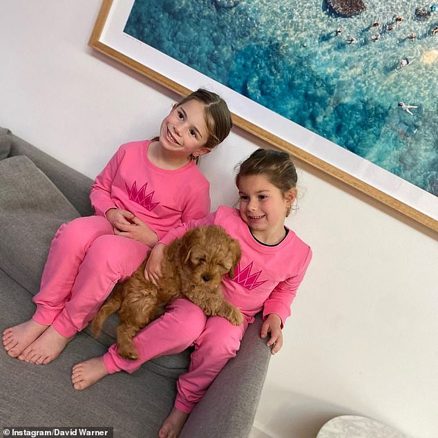 Bonding time: In another photo, Ivy (right) and Indi (left) enjoyed posing for a snap with their pet pooch