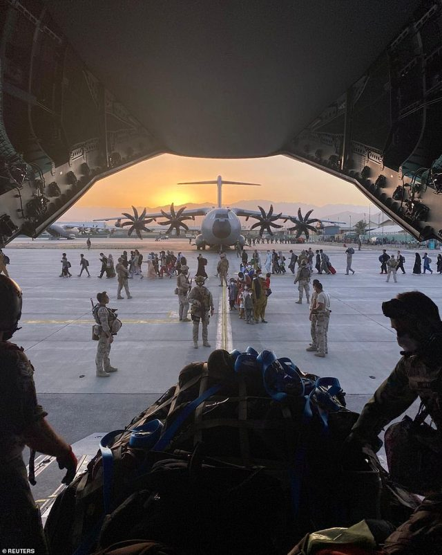 Pictured: Afghan collaborators, their families, Spanish soldiers and members of the embassy board a Spanish military plane as part of their evacuation, at the Hamid Karzai International Airport in Kabul, Afghanistan, August 27, 2021
