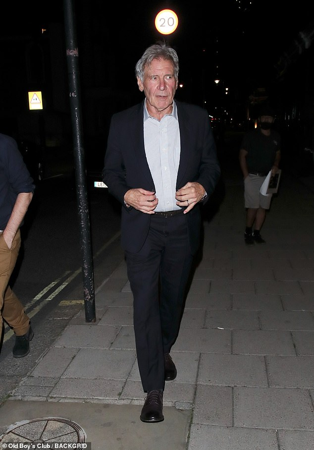 Sighting: Harrison Ford, 79, looked dapper while leaving private members' club George in London on Friday - as he prepares to return to Indiana Jones 5 filming following shoulder injury