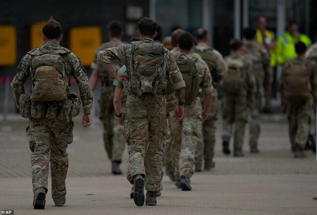 British troops from 16 Air Assault Brigade walk off the runway after arriving back at RAF Brize Norton on Saturday