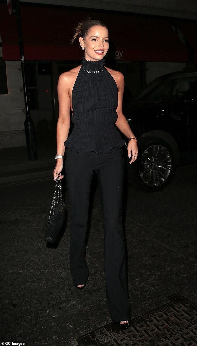Stunning:Maura Higgins looked as stylish as ever as she stepped out in a black backless top while leaving dinner at Isabel restaurant in London with pals on Friday