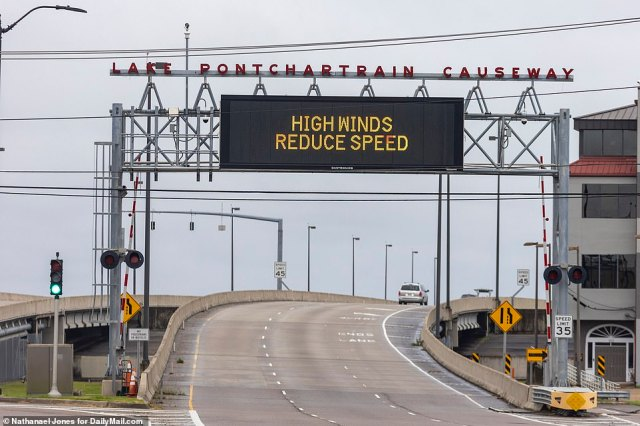 The entrance to the Pontchartrain Causeway in New Orleans displays a high winds warning ahead of Hurricane Ida's projected Sunday arrival - winds are expected to exceed 130MPH