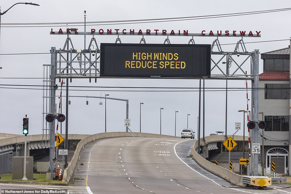 The entrance to the Pontchartrain Causeway in New Orleans displays a high winds warning ahead of Hurricane Ida's projected Sunday arrival - winds are expected to exceed 140MPH