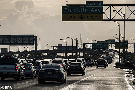 New Orleans ordered residents living in the vicinity of the city's levee system to evacuate and encouraged those living in the rest of the parish to do so voluntarily - since the storm quickly escalated in intensity, Mayor LaToya Cantrell said it wasn't possible to order a mandatory evacuation for the entire city. Pictured are barely-moving vehicles along Interstate 610, packed with evacuating drivers