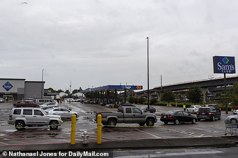 Lines at gas stations were flowing into the streets and an Exxon in New Orleans has already closed its pumps because it is out of gas. Pictured are cars lining up at Sam's Club on Friday to fill up their tanks to evacuate, or to get gas for their generators