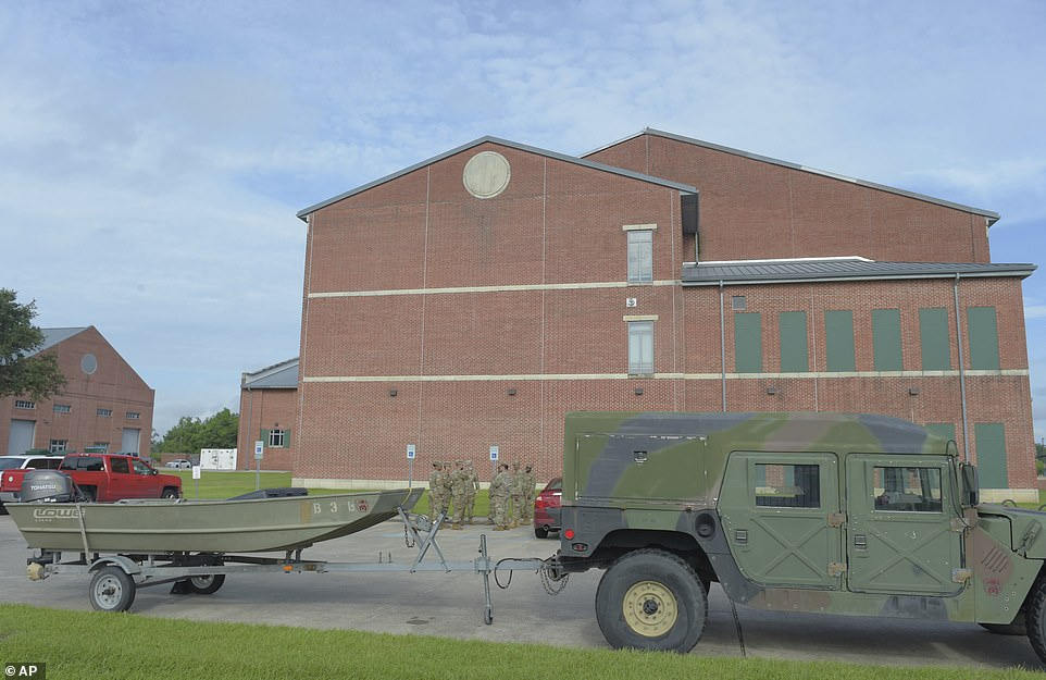 National Guardsmen stage rescue boats at the Jackson barracks in New Orleans on Saturday, preparing to rescue residents from the expected floodwaters resulting from Sunday's hurricane