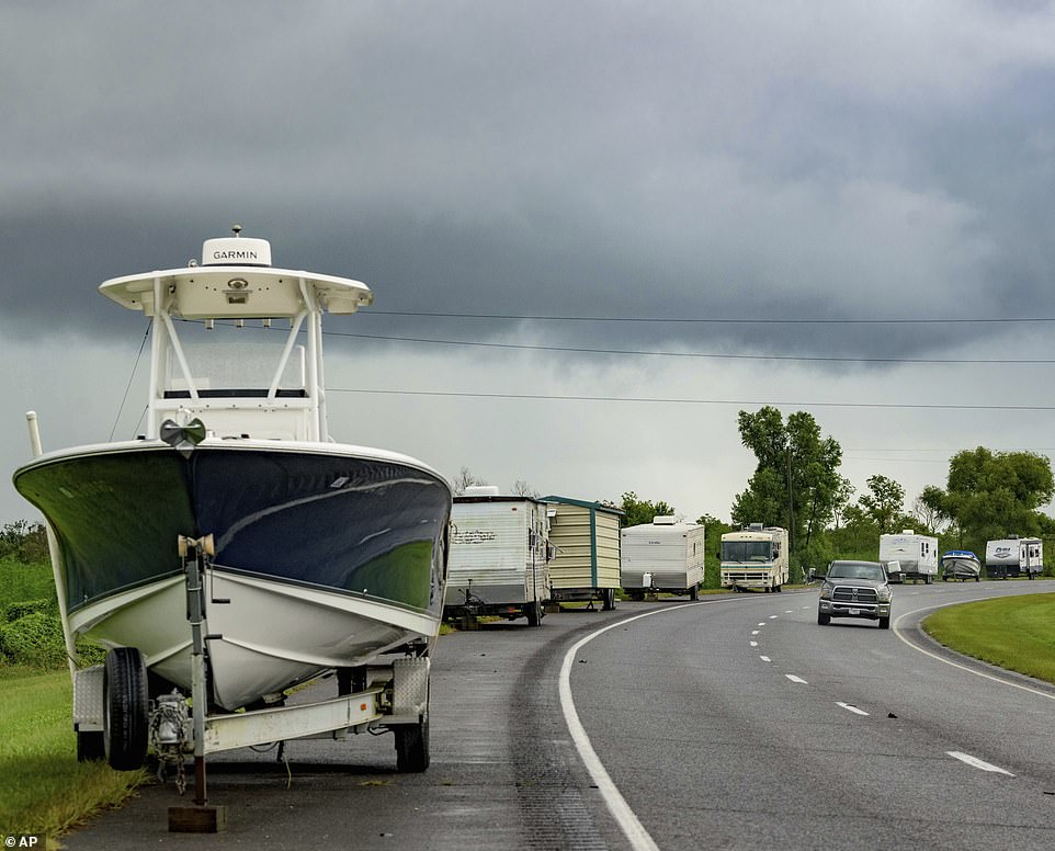 Boats, trailers and RVs line Louisiana Highway 46 as owners race to get them within the area of levee protection on Saturday before Hurricane Ida hits