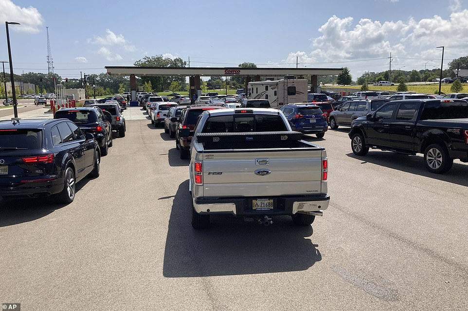 Drivers flock to a Costco gas station on Saturday, hoping to fill up their tanks before Sunday's impending hurricane