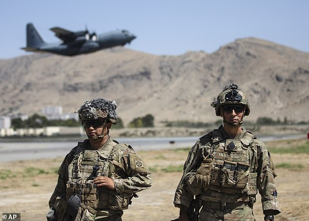 In the beginning, the American military campaign in Afghanistan was officially known as Operation Enduring Freedom. Pictured: Troops in Kabul on August 25
