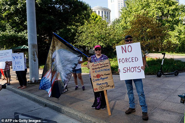 Anti-vaccine mandate protesters demonstrate, on August 24, 2021, outside of the Ohio Statehouse in Columbus, to support the Vaccine Choice and Anti-Discrimination Act