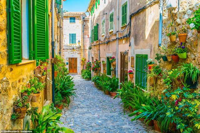 Ambling around the super-cute village of Valldemossa on Mallorca, pictured, is an absolute must