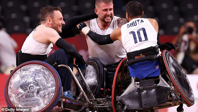 Robinson celebrates ParalympicsGB's victory with Ryan Cowling (left) and Ayaz Bhuta