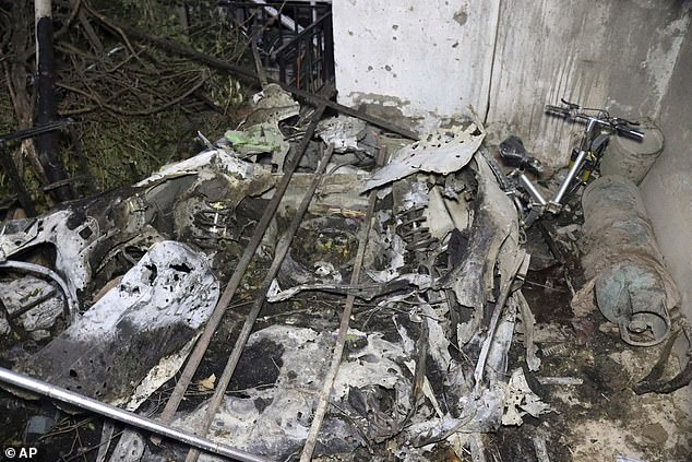 """Parts of a destroyed vehicle are seen inside a house after U.S. drone strike in Kabul, Afghanistan, Sunday, Aug. 29, 2021. A U.S. drone strike destroyed a vehicle carrying """"multiple suicide bombers"""" from Afghanistan's Islamic State affiliate on Sunday before they could attack the ongoing military evacuation at Kabul's international airport, American officials said"""