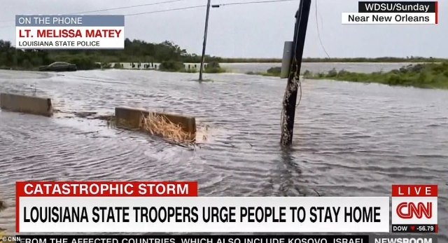 Louisiana state troopers have been urging residents to shelter in place and avoid sight seeing as Hurricane Ida raged across the state on Sunday, as reported by CNN. Above, streets in New Orleans were flooded in the storm's wake