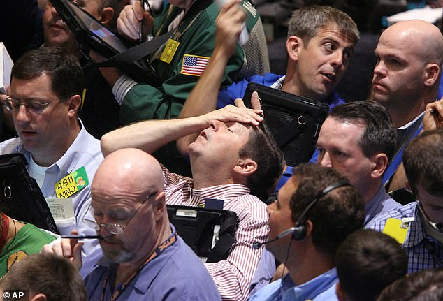 Paulson's firm made $20 billion after buying $1 billion worth of insurance against risky mortgages. Above, traders at the New York Mercantile Exchange in September 2008