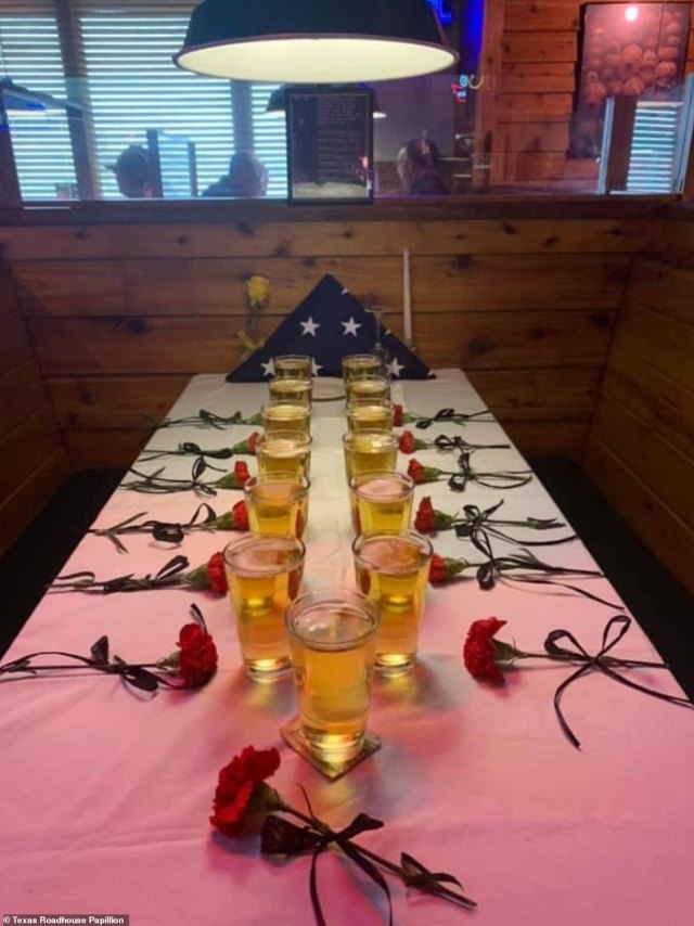 Texas Roadhouse in Papillion, Nebraska paid tribute to the 13 troops killed with beers and red carnations