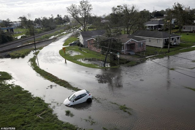 The image above shows flooded streets in Kenner, Louisiana on Monday - a day after Hurricane Ida rampaged through the area