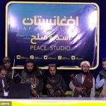Terrified Afghan TV news presenter reads headlines while surrounded by gun-toting Taliban thugs 💥👩💥