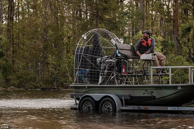 A man preps an airboat to assist in search and rescue missions related to flooding from Hurricane Ida in Jean Lafitte, Louisiana