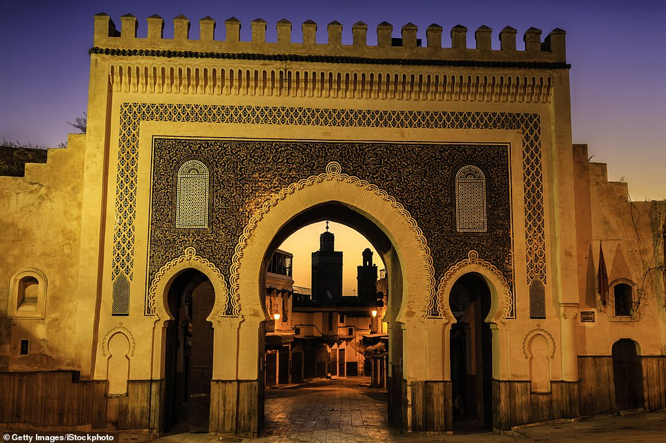 Bab Bou Jeloud, the impressive entrance to Fez's ancient medina, which is decorated with tiles and geometric motifs