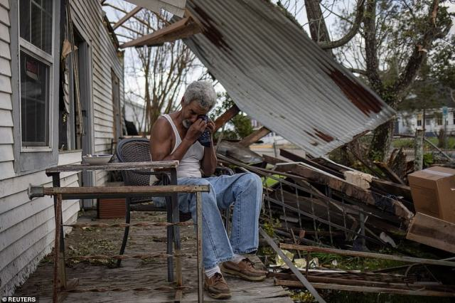 Pictured: Theophilus Charles, 70, weeps while sitting on the front porch of his heavily damaged home in the aftermath of Hurricane Ida in Houma, Louisiana, U.S., August 30, 2021