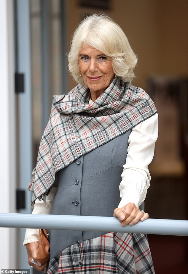 Elegance: Camilla opted for a black, grey and red check, which she wore in a knee-length skirt covered with an elegant cream blouse and grey waistcoat