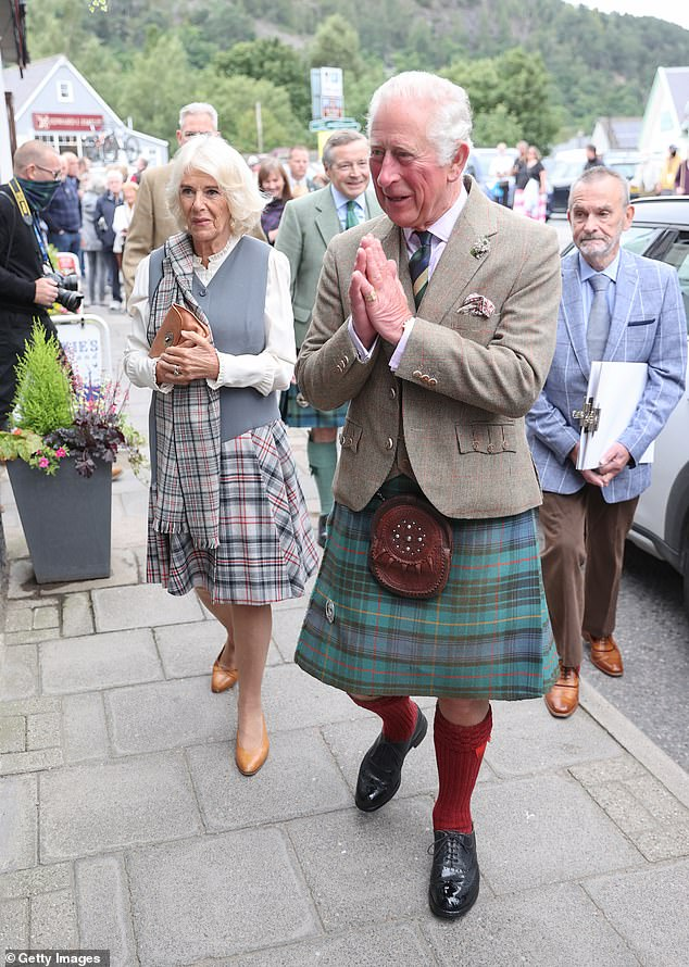 Charles and Camilla were greeted by throngs of well-wishers in the small Scottish village