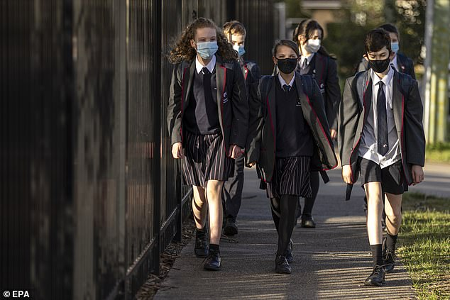 It is likely that children in other age groups will continue to learn from home (pictured, Bentleigh Secondary College students after the previous lockdown)