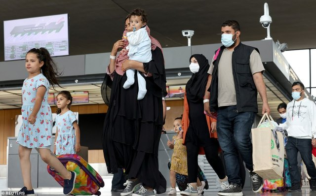 Afghan refugees arrive at Dulles International Airport in Virginia
