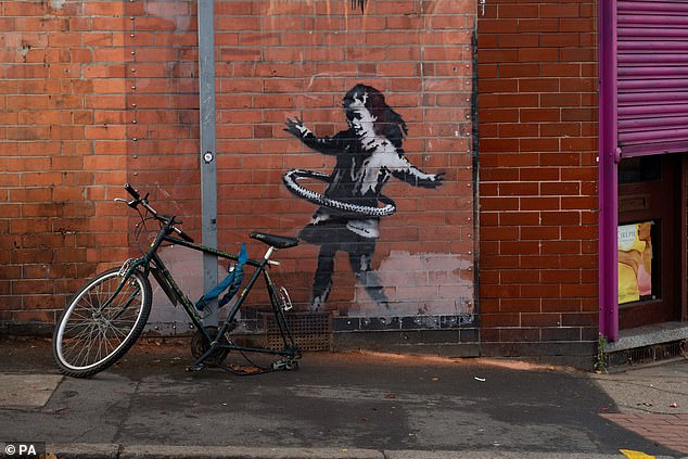 An artwork painted by Banksy on the side of a property at Rothesay Avenue and Ilkeston Road in Nottingham