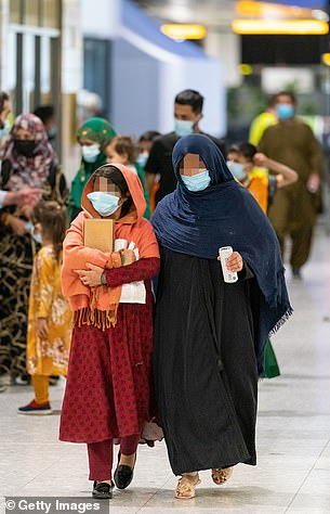 Refugees from Afghanistan arrive on a evacuation flight at Heathrow Airport on August 26