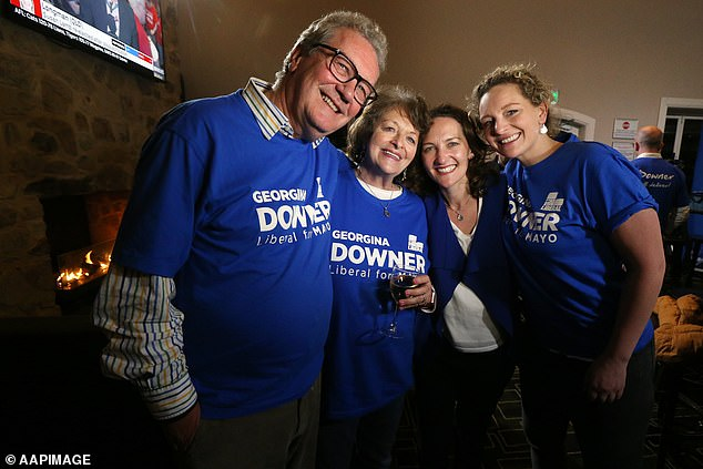 Liberal candidate Georgina Downer (second right) poses for a photographer with father Alexander Downer (left), mother Nicky Downer and sister Henrietta (right) at the Barker Hotel, Adelaide, South Australia in 2018