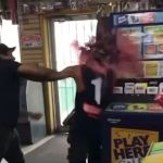 Moment petrol station attendant smashes entire bottle of red wine over customer's head 💥👩💥