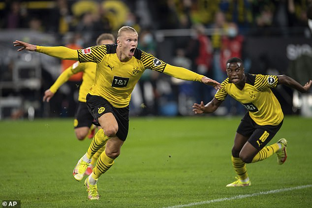 The young Borussia Dortmund striker (left) is one of the most in-demand players in the world