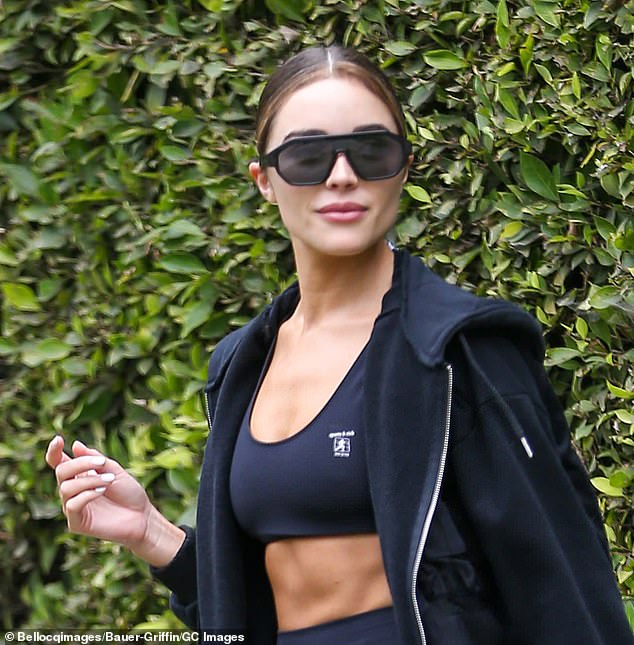 Close-up: Culpo shielded her flawless complexion with large sunglasses and she styled her blonde-streaked locks into a middle-parted bun for her workout