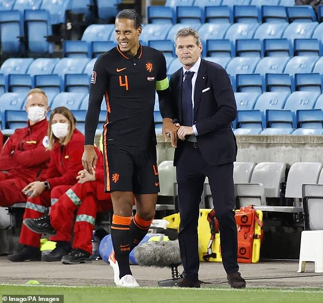 Virgil van Dijk had a dislocated finger put back into place during the Netherlands' World Cup qualifier against Norway on Wednesday night (above)