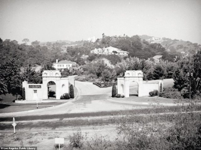 BEL AIR GATES: This image was captured in 1925. That same decade, oil millionaire Alphonso Bell founded Bel Air. Hidden behind Spanish Gates on Sunset Boulevard are the homes of the rich and famous, according to the author. Celebrities seeking privacy – like Greta Garbo or Sophia Loren – retreated to Bel Air's 'secluded lush and leafy grounds'. In 1946, the Bel Air hotel opened, with the likes of the Rockefellers and the Kennedys regularly spending the night in its hallowed halls. In November 1961, tragedy struck the neighborhood when a fire swept through Bel Air, claiming 484 homes and twenty-one other buildings