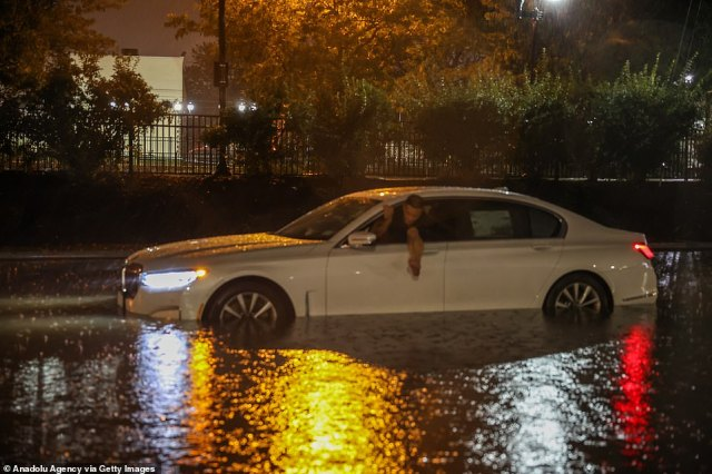 BAYONNE CITY, NEW JERSEY: Cars sit sunken on Highway 440 after a flash flood
