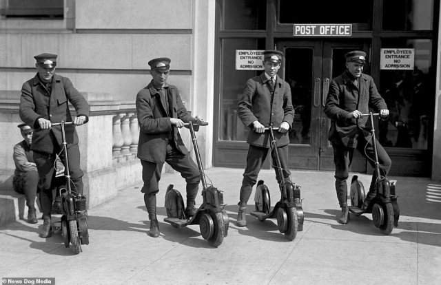 Four special delivery postmen for the US Postal Service try out their new scooters, known as the Autoped, in 1916. The image is part of a set showing the first ever motorised scooter craze over a hundred years ago