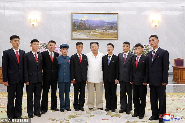 Pictured:North Korean leader Kim Jong Un poses as he meets young people, during Youth Day celebrations, in Pyongyang, North Korea, in this image supplied by North Korea's Korean Central News Agency on August 31, 2021
