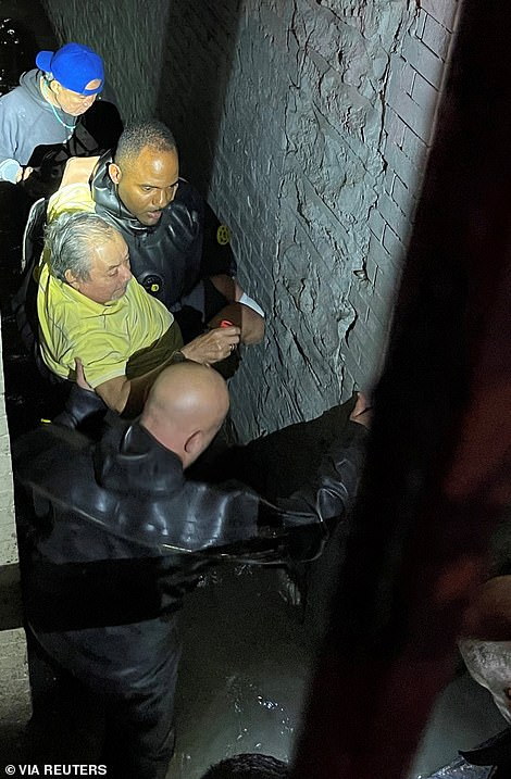 NYPD teams in diving gear rescue a disabled man and his dog from a flooded home on Wednesday night