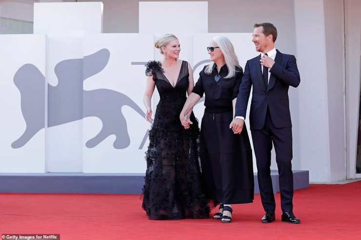 Beaming: Kirsten beamed while posing with co-starBenedict Cumberbatch and directorJane Campion