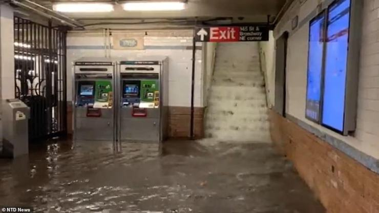 A city underwater: 145th Street station on Wednesday night after Hurricane Ida brought nearly 6 inches of rain to New York City - 3.5inches in an hour - the single highest rainfall ever recorded. Nine people in the city died