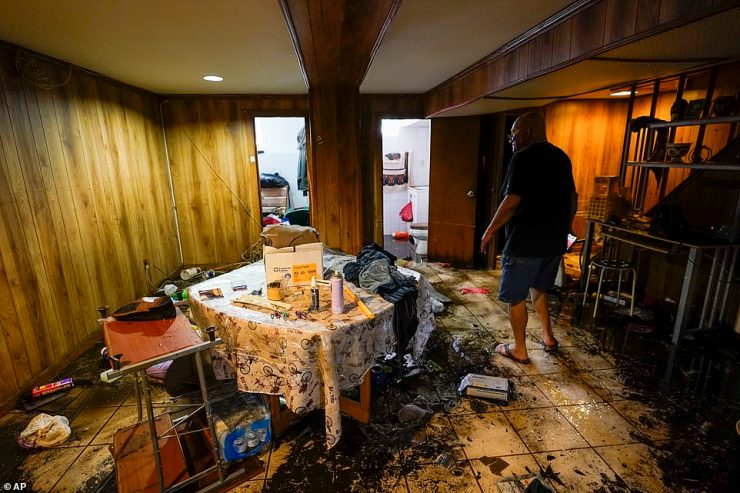 One neighbor showed the inside of his sodden basement apartment, proving just how high the floodwaters rose