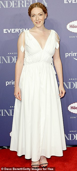 Stunning:Actress Charlotte Spencer, who styled her gorgeous ginger locks into a plait, looked heavenly in a brilliant white dress