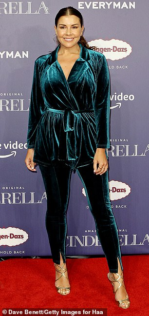 Hot stuff:Imogen Thomas put her best fashion foot forward in a teal co-ord, consisting of a velour blazer and skinny trousers