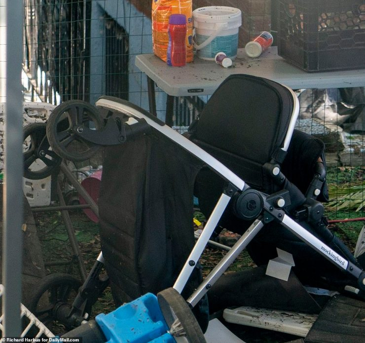 A stroller is seen sitting abandoned outside the home on Thursday. Tributes are now coming in