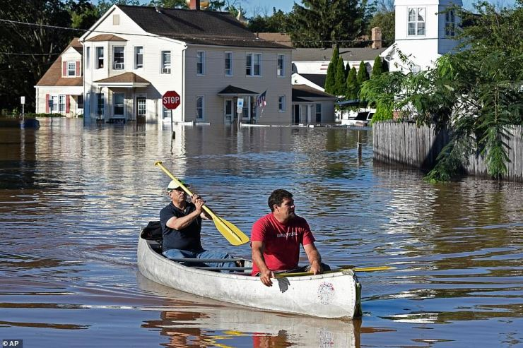 Residents canoe through floodwater in the aftermath of Hurricane Ida in Manville, NJ, Thursday, Sept. 2, 2021