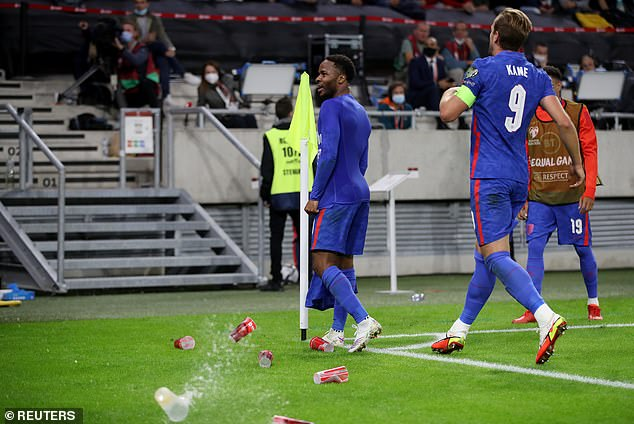 The England striker was also pelted with cups of beer as he celebrated his second-half strike