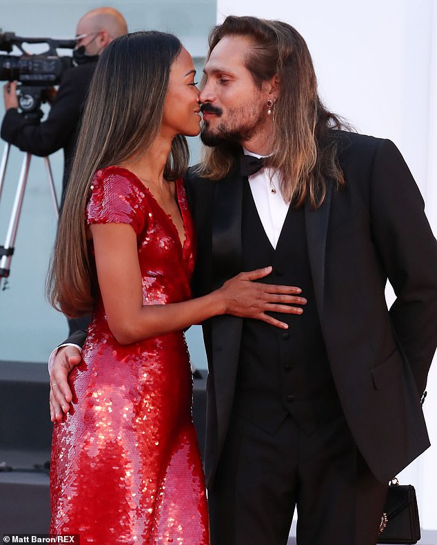 Mwah! Zoe Saldana packed on the PDA with her husband Marco Perego at Venice Film Festival on Thursday night